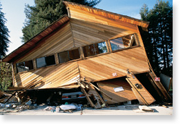 Photo of soft story house, collapsed from the 1989 Loma Prieta earthquake.